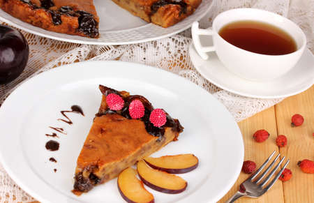 Tasty pie on plate on wooden table Stock Photo - 16911844