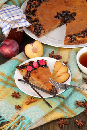 Tasty pie on plate on wooden table Stock Photo - 16912473