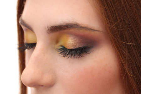 beautiful female eyes with bright autumn make-up photo