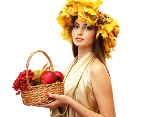 beautiful woman with wreath and basket with apples and berries, isolated on white photo