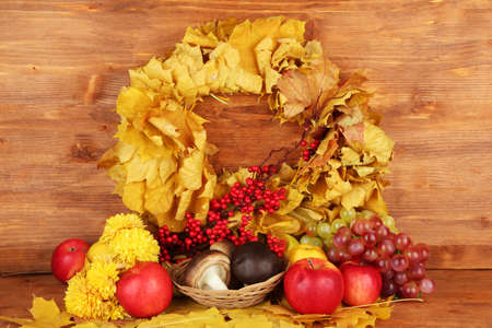 Autumnal composition with yellow leaves, apples and mushrooms on wooden background Stock Photo - 16912642