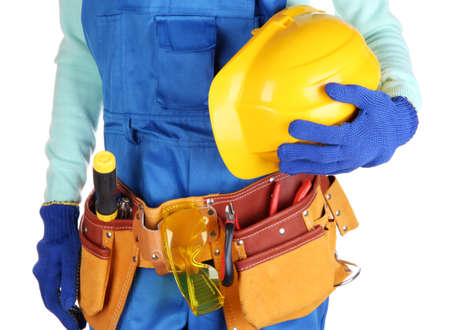 electrical safety: Male builder in blue overalls with yellow helmet  isolated on white