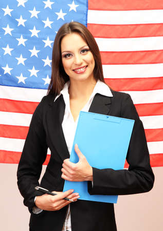 Young woman with American flag photo