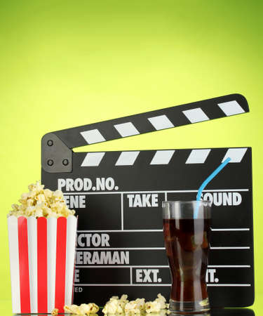 Movie clapperboard, cola and popcorn on background Stock Photo - 16911114