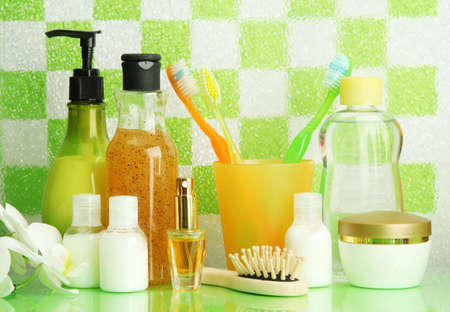 Bath accessories on shelf in bathroom on green tile wall background Stock Photo - 16911847