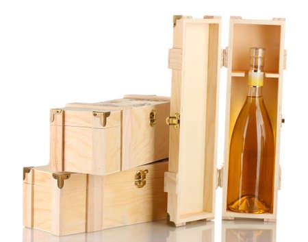 bottleneck: Wine bottle in wooden box, isolated on white Stock Photo