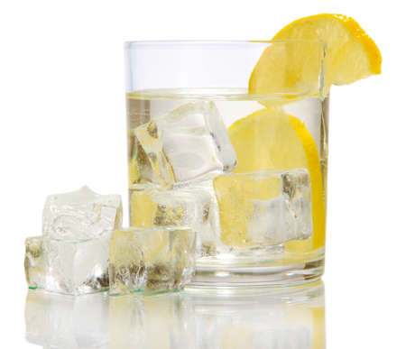Ice cubes in glass with lemon isolated on white Stock Photo - 16911046