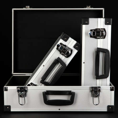 Silvery suitcases on black background Stock Photo - 16912654