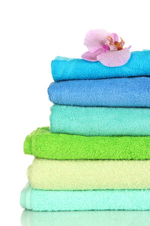 Stack of towels with fragrant flower isolated on white Stock Photo - 16912371