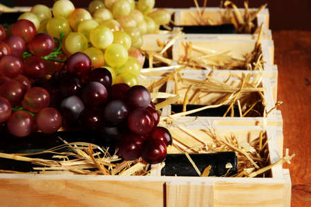 Wooden case with wine bottles close up Stock Photo - 16912270