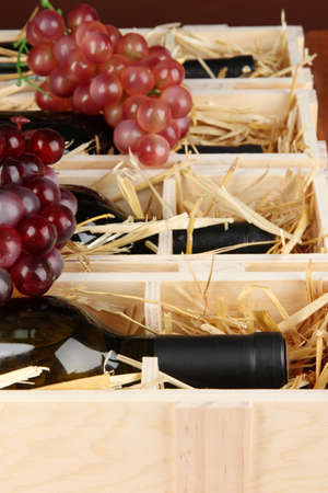 Wooden case with wine bottles close up Stock Photo - 16911839
