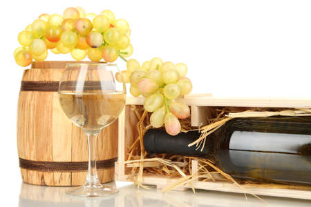 Wooden case with wine bottle, barrel, wineglass and grape isolated on white photo
