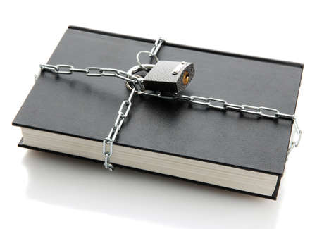 black book with chain, isolated on white photo