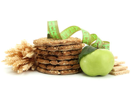 tasty crispbread, apple, measuring tape and ears, isolated on white photo