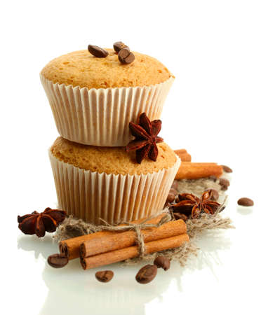 tasty muffin cakes on burlap, spices and coffee seeds, isolated on white Stock Photo
