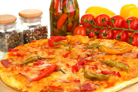 Tasty pepperoni pizza with vegetables on wooden board close-up photo