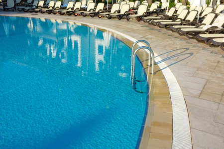Hotel swimming pool with sunny reflections Stock Photo - 16939940