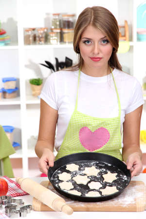 A young girl in kitchen during cooking biscuits Stock Photo - 17282630