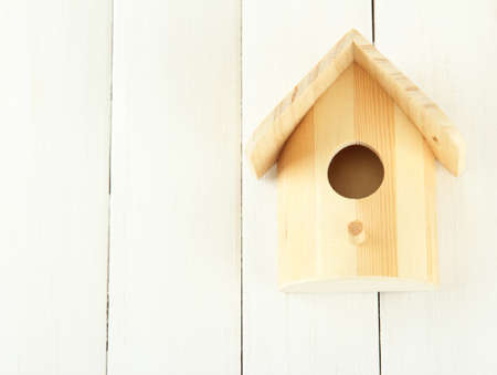 Nesting box on wooden background photo