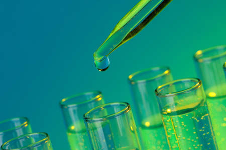 test-tubes with liquid on blue background Stock Photo - 16939294