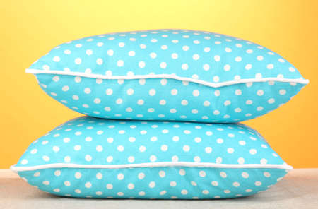 Blue bright pillows on orange background photo