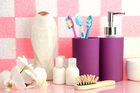 Bath accessories on shelf in bathroom on pink tile wall background Stock Photo - 16939255