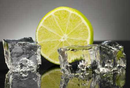 Ice cubes with lime on black background Stock Photo - 16939343