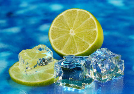 Ice cubes with lime on blue background Stock Photo - 16939989