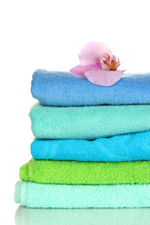 Stack of towels with fragrant flower isolated on white Stock Photo - 16939928