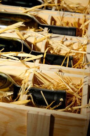 Wooden case with wine bottles close up Stock Photo - 16939990