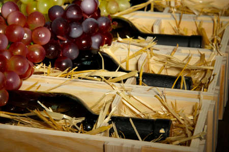 Wooden case with wine bottles close up Stock Photo - 16940017