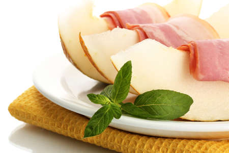 parma ham and melon, isolated on white photo
