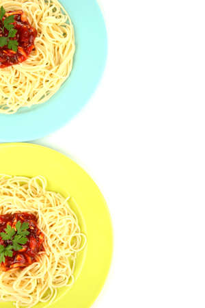 Italian spaghetti in plates isolated on white photo