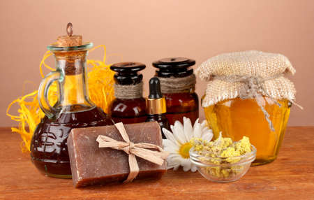 ingredients for soap making on brown background photo