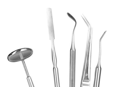 Set of dental tools for teeth care isolated on white photo