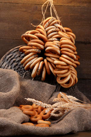 boublik: tasty bagels and spikelets on wooden background Stock Photo