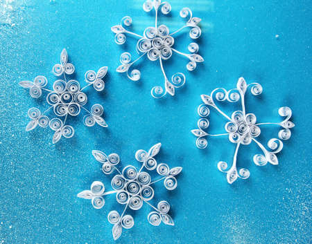 beautiful paper snowflakes, on blue background photo