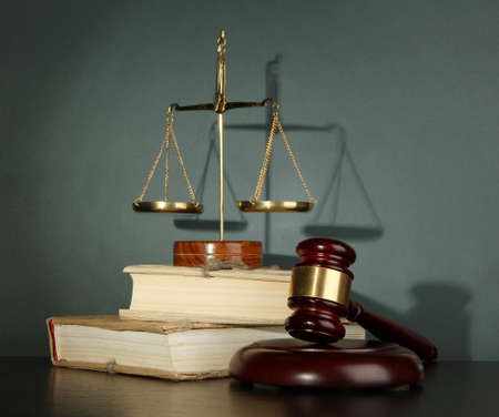 Golden scales of justice, gavel and books on grey background Stock Photo - 16997128