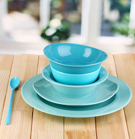 Blue tableware on wooden table on window background Stock Photo - 16998902