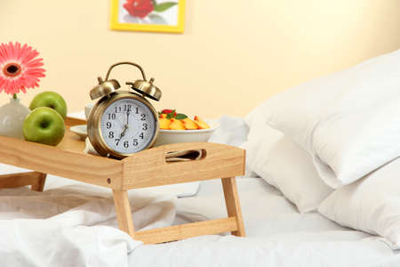 wooden tray with light breakfast on bed Stock Photo - 17001058