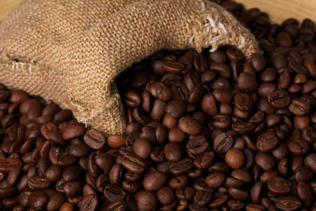 Coffee beans in bag close-up photo