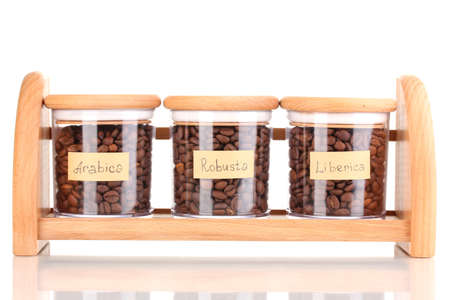 Coffee beans in jars isolated on white photo