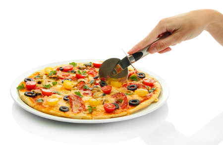 woman's hand with a knife cut the pizza on white background close-up Stock Photo - 16998786