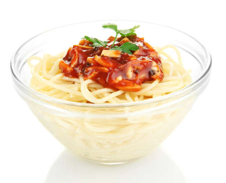 Italian spaghetti in glass bowl isolated on white photo