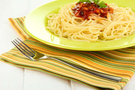 Italian spaghetti in plate on wooden table photo