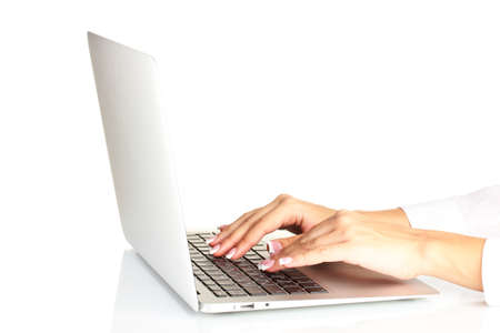 business womans hands typing on laptop computer, on white background close-up photo