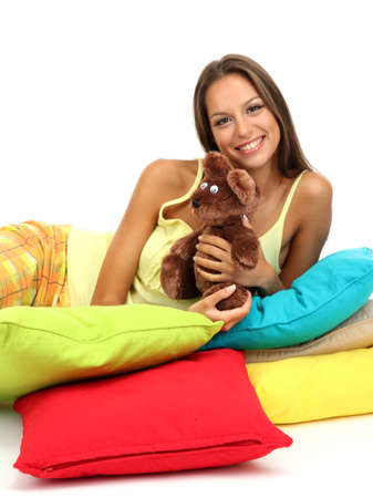 beautiful young girl and fluffy bear with pillows isolated on white Stock Photo - 17281856