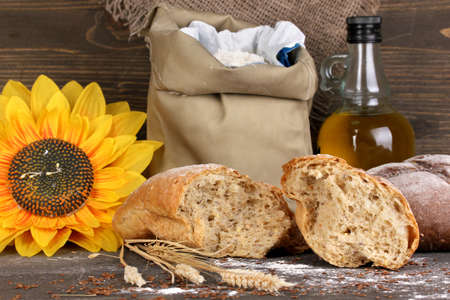 Rye bread on wooden table on wooden background Stock Photo - 17001572