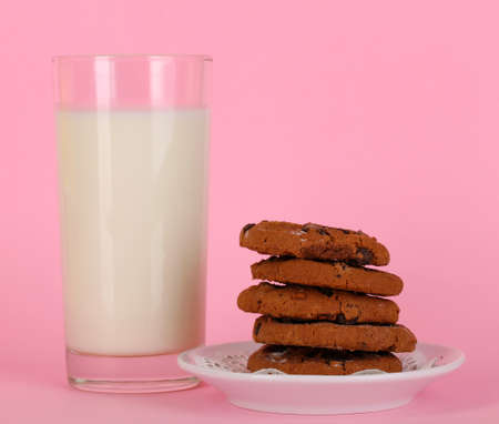 Glass of fresh new milk on pink background photo