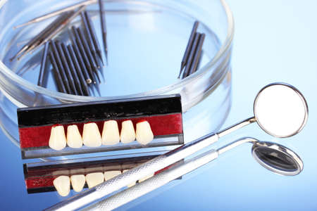 denture with dental tools on blue background Stock Photo - 17001361